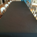 A covering of black craft paper gets rolled out for a carefree table covering.