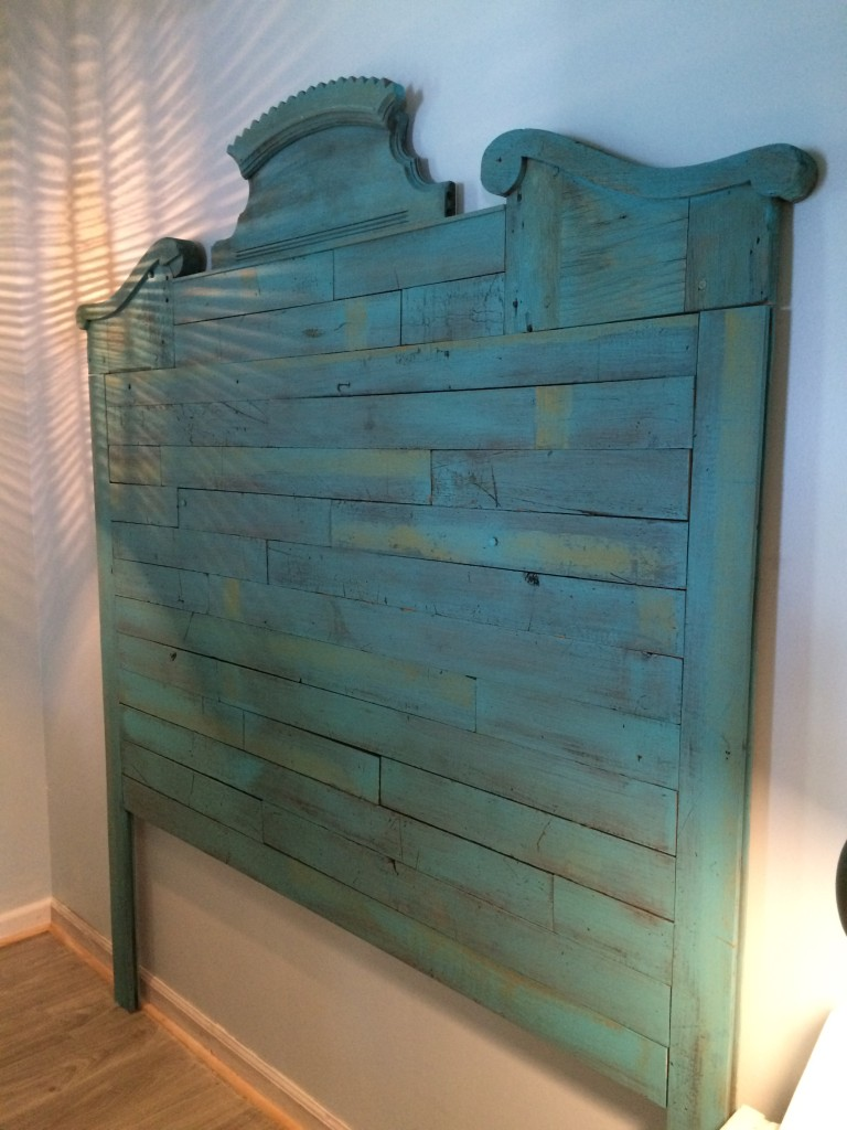 Itsy Bitsy Lakeside Cottage Master Bedroom DIY Headboard made from reclaimed flooring boards, church pews, and mirror parts.