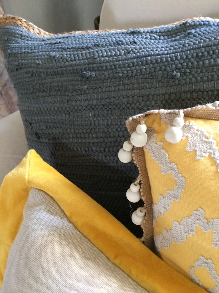 Texture and pattern:Mixing yellow and grays for a sophisticated living room makeover with Meme Hill.