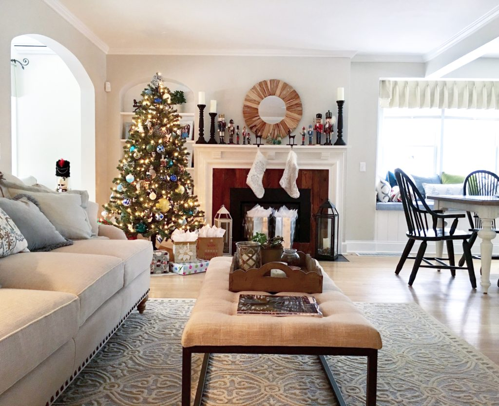 christmas-tree-coastal-wood-neutral-beautiful-interiors-meme-hill-rug-ottoman-fireplace-mantel-turquoise-nautical