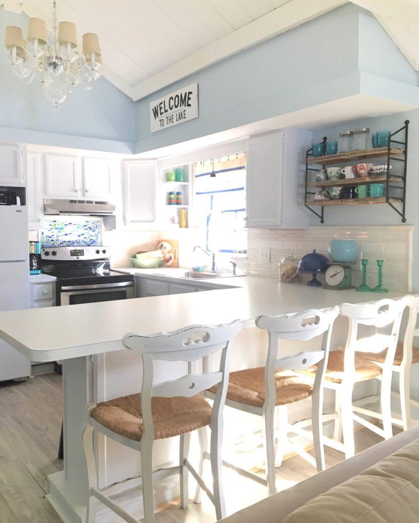 honeoye-lake-cottage-summer-house-interior-kitchen-white-lakehouse-renovation-diy-hgtv-backsplash-painted-cabinets-finger-lakes