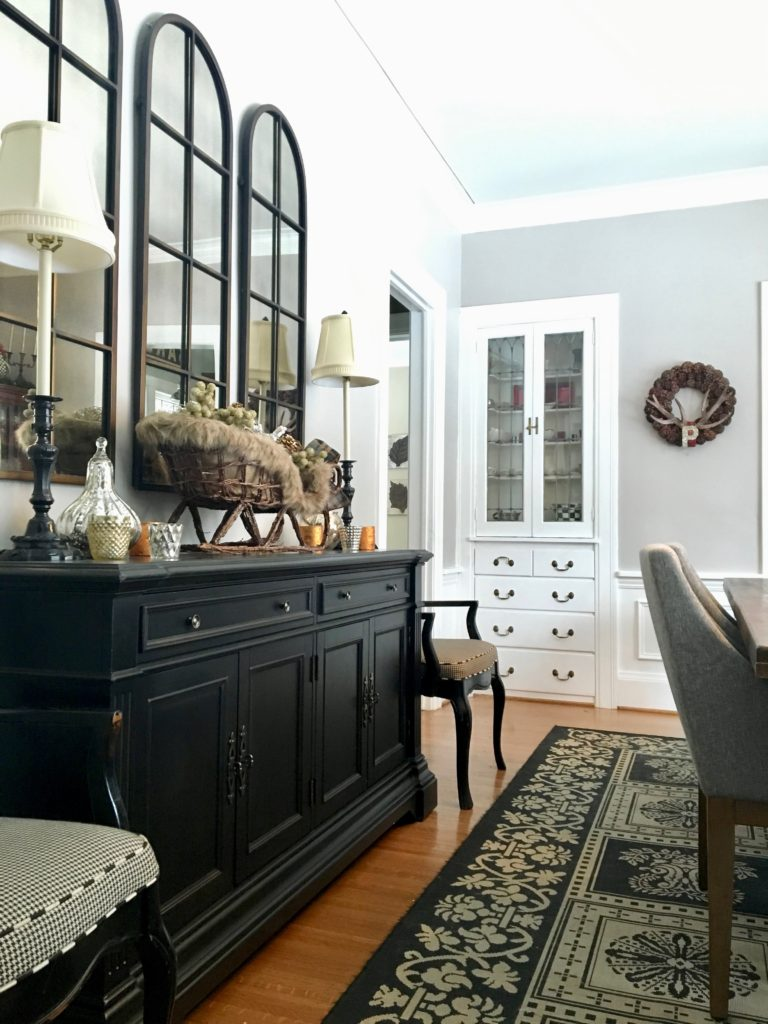 meme-hill-beautiful-dining-rooms-black-buffet-server-sideboard-white-gray-room-arched-mirrors-raymour-flanigan-west-elm-chair