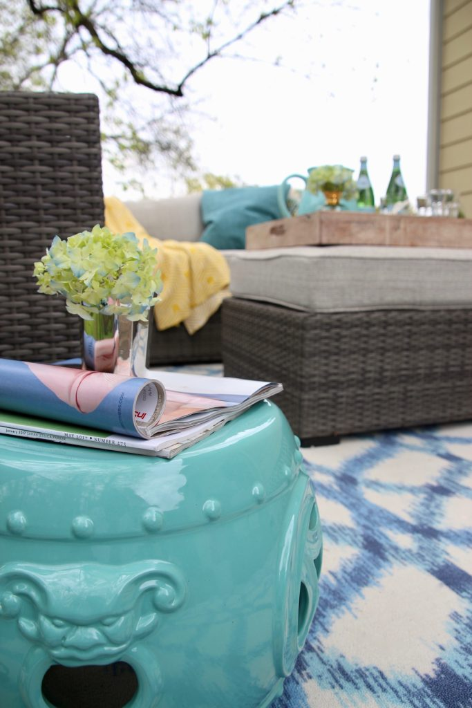 space_patio_space_solutions_outdoor_entertaining_Raymour_flanigan_sofa_homegood_pillows_turquoise_ottoman_tray_garden_stool
