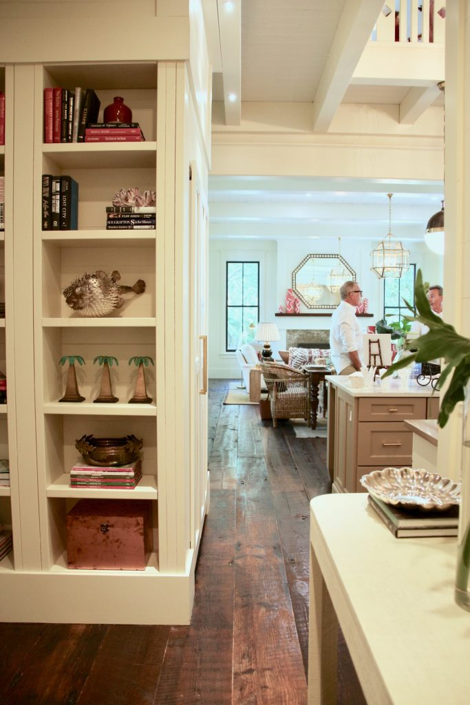 Southern _living_Idea_House_2017_Delta_faucet_bald_head_island_Meme_hill_Master_hallway_built_in_bookcases_coastal_chandelier