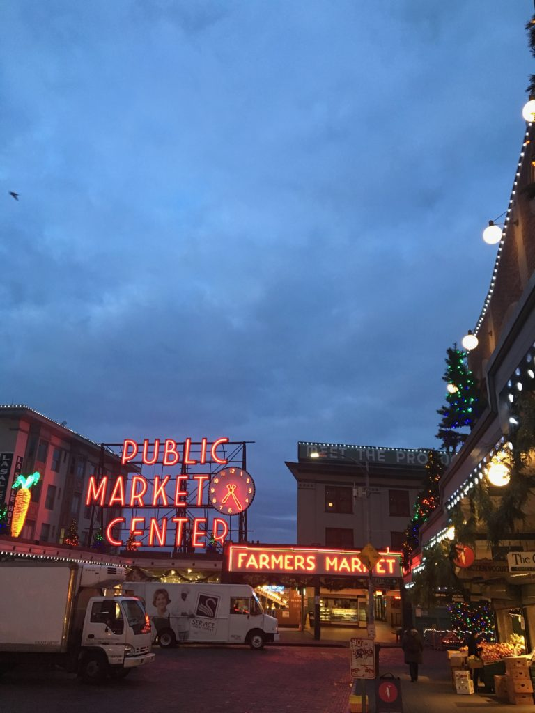HGTV_Dream_home_Seattle_WA_Gig_Harbor_2018_Delta_faucet_amie_freling_meme_hill_gum_wall_pikes_place_market_alley_neon_sign_dusk