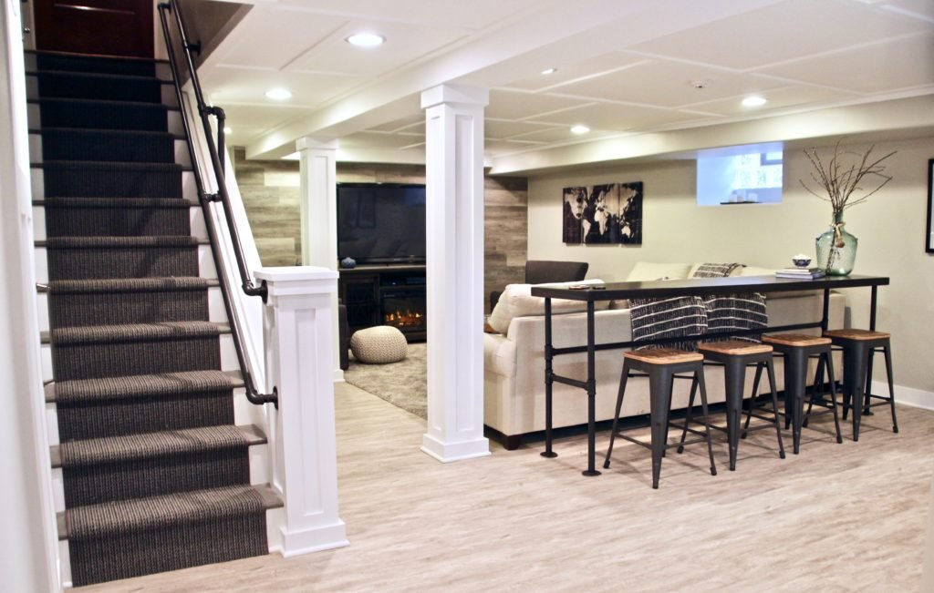 Cozy up with this charming farmhouse inspired basement for Farmhouse basement