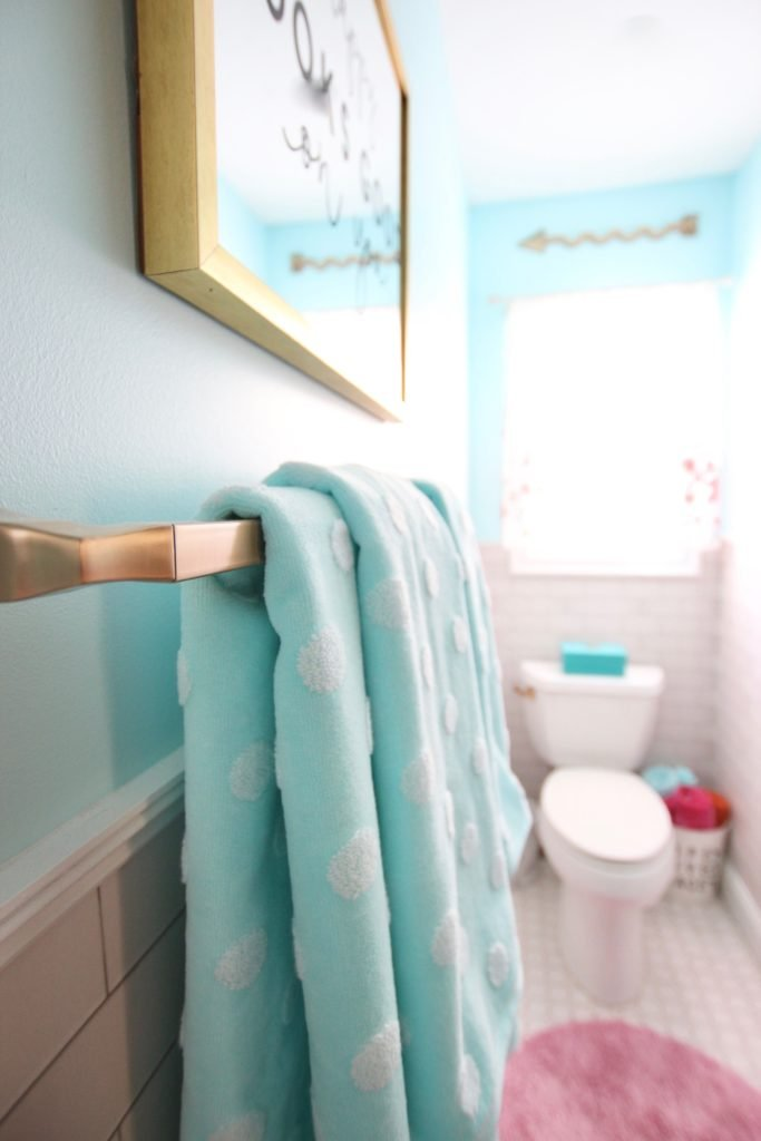 Meme_Hill_bathroom_teen_Makeover_pink_turquoise_subway_tile_glam_chic_gold_delta_faucet_Dryden_champagne_bronze