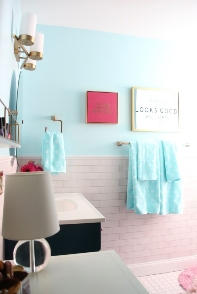 Meme_Hill_bathroom_teen_Makeover_pink_turquoise_subway_tile_glam_chic_gold_delta_faucet_Dryden_champagne_bronze_mirror
