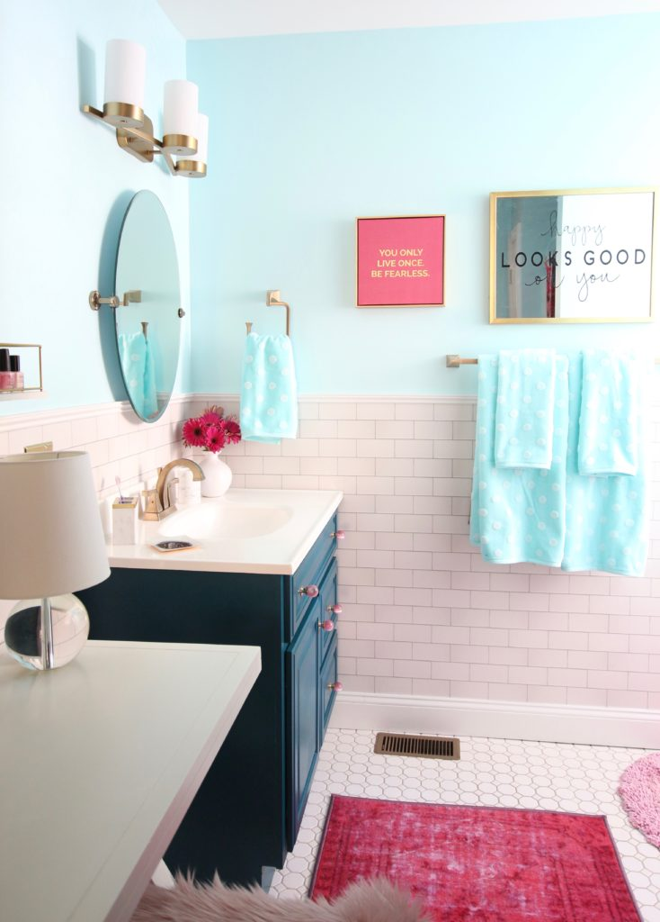 Meme_Hill_bathroom_teen_Makeover_pink_turquoise_subway_tile_glam_chic_gold_delta_faucet_Dryden_champagne_bronze_painted_vanity