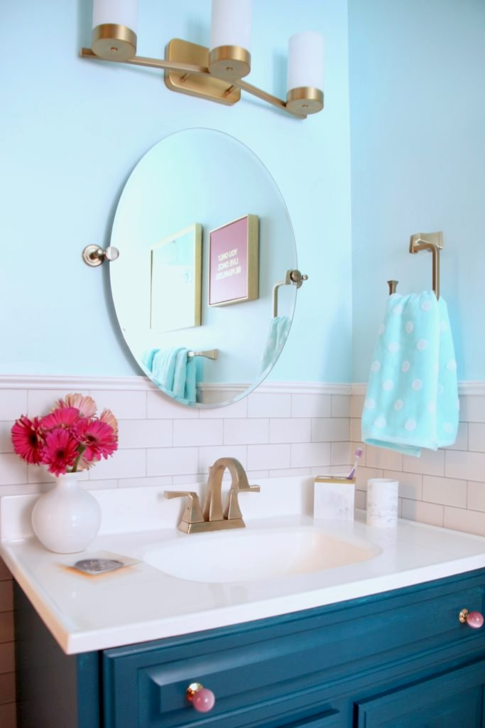 Meme_Hill_bathroom_teen_Makeover_pink_turquoise_subway_tile_glam_chic_gold_delta_faucet_Dryden_champagne_bronze_tilting_mirror