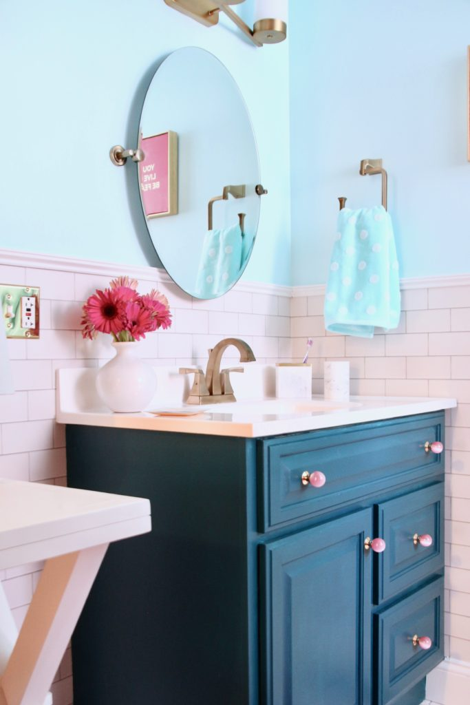 Meme_Hill_bathroom_teen_Makeover_pink_turquoise_subway_tile_glam_chic_gold_delta_faucet_painted_vanity_knobs