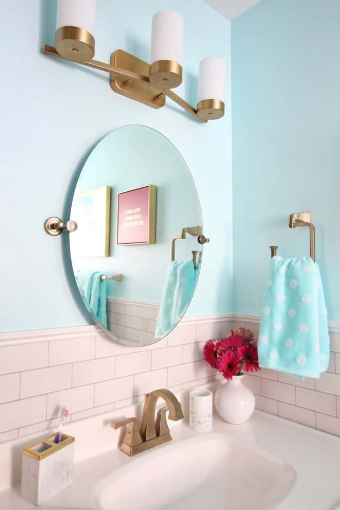 Meme_Hill_bathroom_teen_Makeover_pink_turquoise_subway_tile_glam_chic_gold_delta_faucet_progress_elevate_lighting