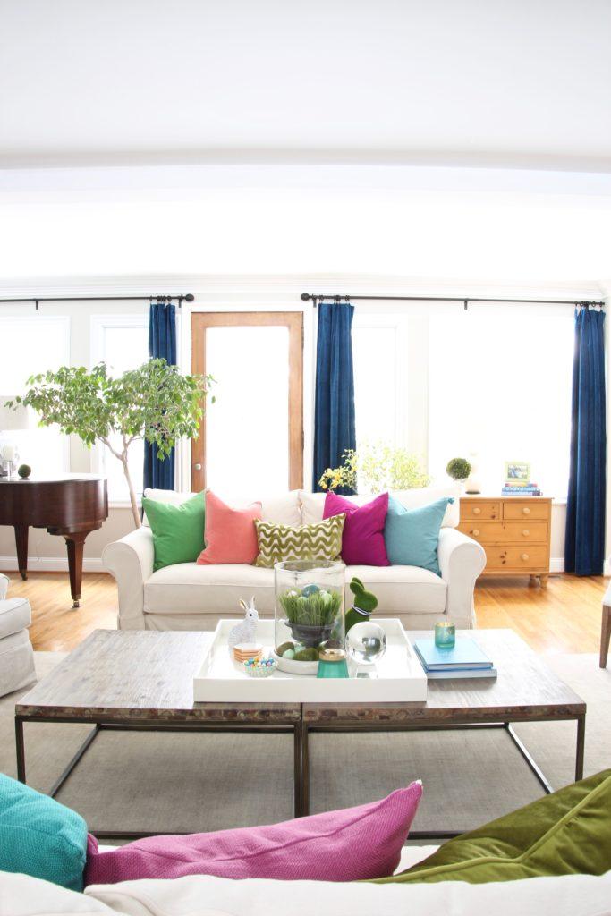 Meme_HIll_Studio_Amie_freling_easter_decorating_livingroom_colorful_ideas_pillows_homeGoods_art_flowers_sofa_white_slipcovered
