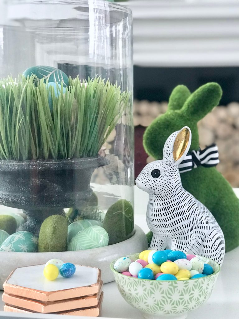 Meme_HIll_Studio_Amie_freling_easter_decorating_livingroom_colorful_ideas_pillows_homeGoods_art_flowers_sofa_white_slipcovered_books_styling_candy_rabbits