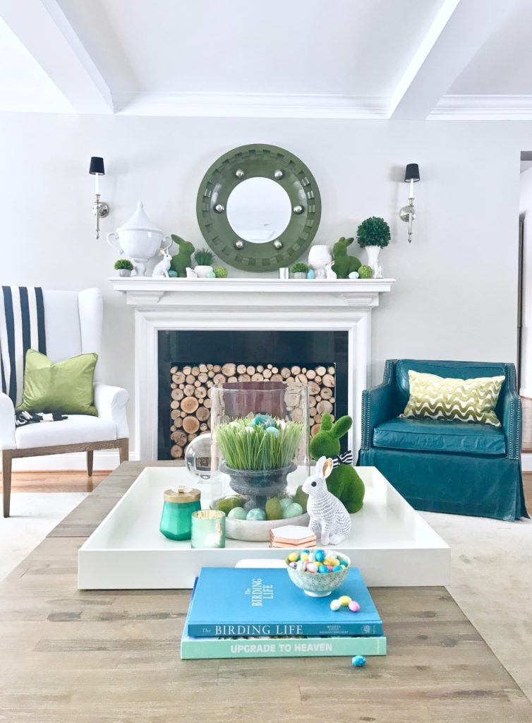 Meme_HIll_Studio_Amie_freling_easter_decorating_livingroom_colorful_ideas_pillows_homeGoods_art_flowers_sofa_white_slipcovered_books_styling_fireplace_mantel
