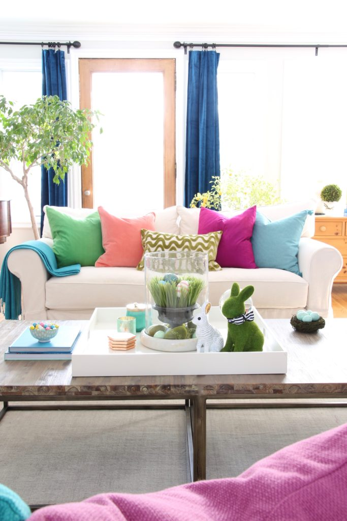 Meme_HIll_Studio_Amie_freling_easter_decorating_livingroom_colorful_ideas_pillows_homeGoods_art_flowers_sofa_white_slipcovered_coffee_table