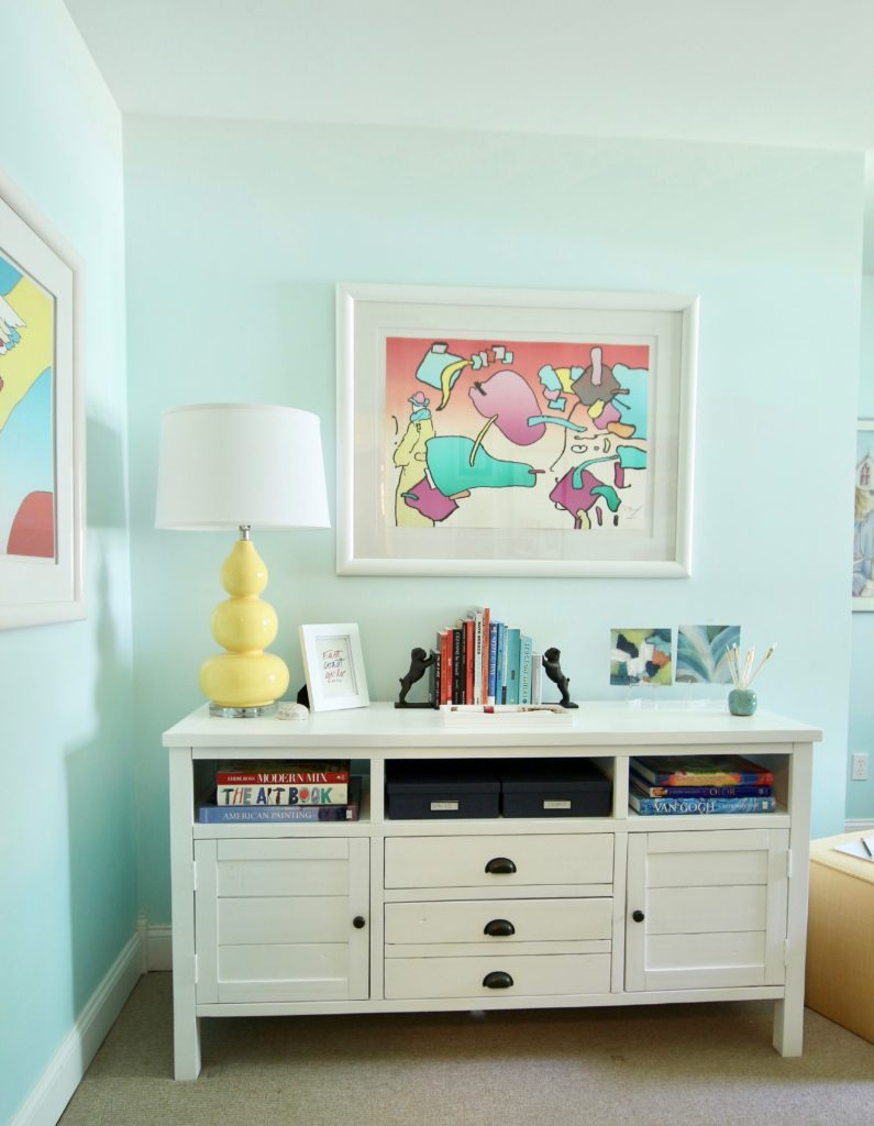 raymour flanigan tv console, tv cabinets, yellow lamps, cool artwork, peter Max