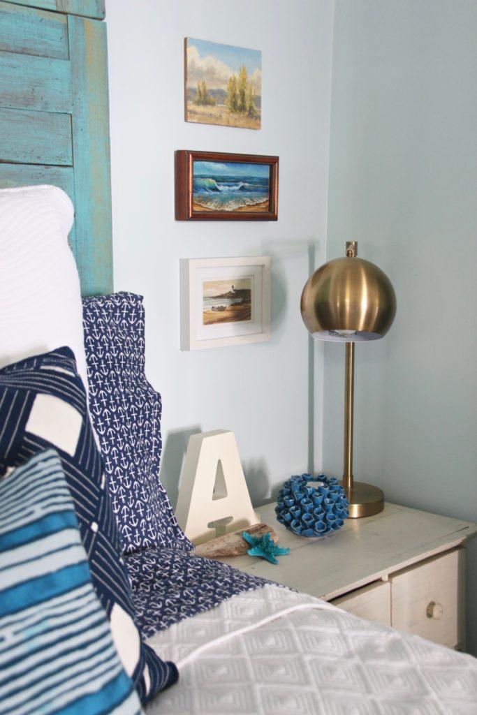 brass bedside lamps, beach artwork, nautical bedding