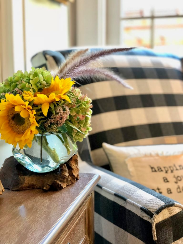 black and white chair, buffalo check chairs. black plaid ginghams chairs, Raymour & Flanigan, comfortable accent chairs, sunflowers and velvet pumpkins