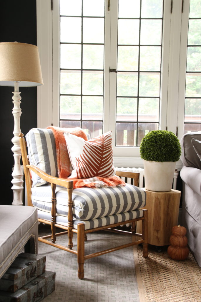 striped gray and white fabric, farmhouse chairs, black wall paint colors