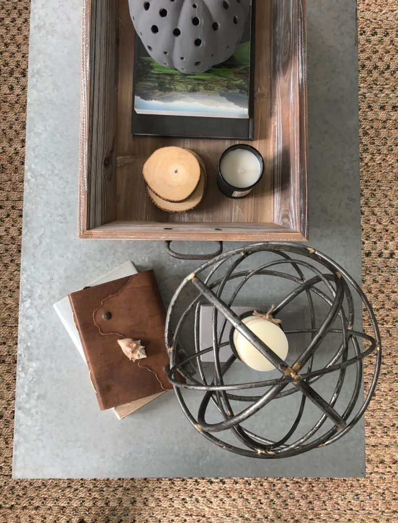 coffee table flat lay, iron candle holder and cement , metal table tops
