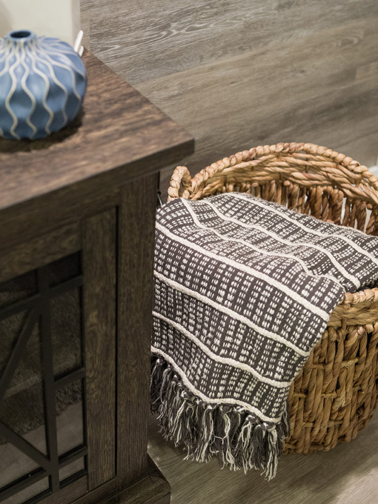 farmhouse style basement remodeling ideas, wooden trays, storage ideas, pretty wicker baskets,