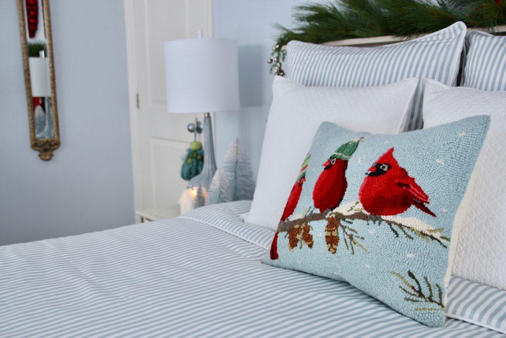 , luxury gift baskets, christmas decorating ideas, bedroom decor, plaid ottoman, needlepoint pillows, cardinal pillows