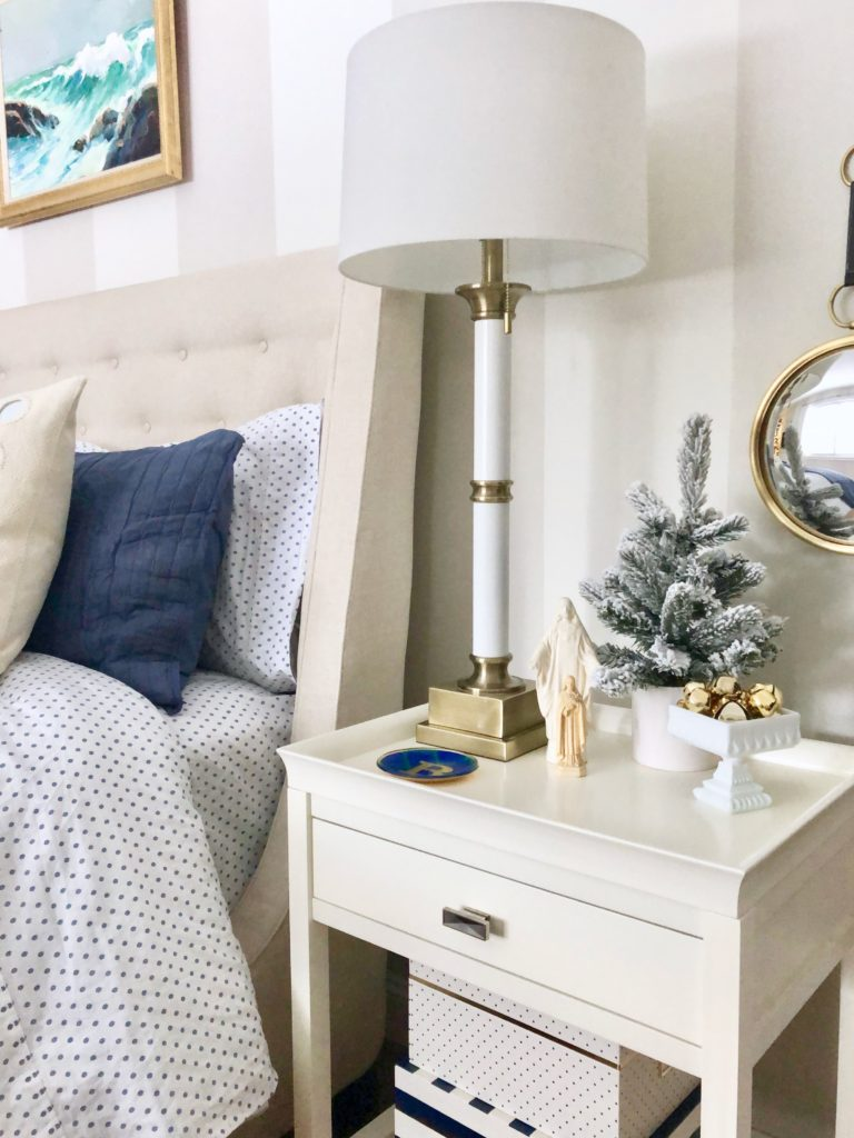 hanging artwork in your master bedroom, decorating ideas, christmas bedroom ideas, white pretty nightstands