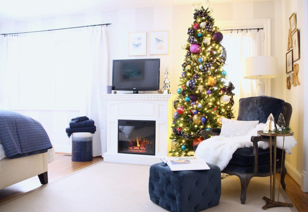 decorating your master bedroom, using navy in decor, gorgeous bedrooms, bedroom christmas trees, mackenzie childs bottle brush trees, novograts ottoman velvet